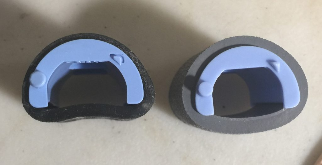 Photo of two HP pickup rollers, the one on the left is the original, with a stretched out, thinner rubber band, and the one on the right is bouncier and thicker.